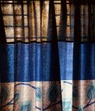 Blue curtain clothes of a window photograph. Beautiful blueish clothes of a window curtain unique background photo royalty free stock photos