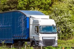 Blue curtain side lorry truck on uk motorway in fast motion.  stock photos
