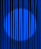 Blue curtain with a spotlight Royalty Free Stock Photos