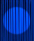 Blue curtain with a spotlight Royalty Free Stock Photos