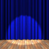 Blue curtain stage with a spot light Stock Photo