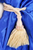 Blue curtain with tassel Royalty Free Stock Image