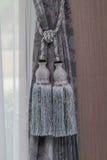 Blue curtain tie Stock Image