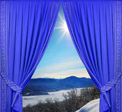 Blue curtains behind the window winter Stock Images