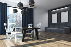 Blue curtains dining room corner, poster. White dining room interior with a large window with blue curtains on it, a long wooden table and white chairs. Two Stock Photography