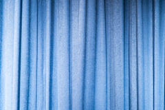 Blue curtains onstage. Curtains down on a stage Royalty Free Stock Photos