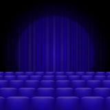 Blue Curtains with Spotlight and Seats Royalty Free Stock Photo