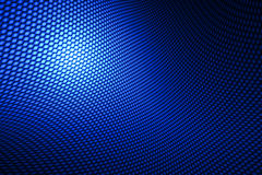 Blue curve carbon fiber. On the black shadow. background and texture royalty free illustration