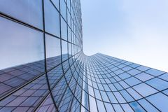 Free Blue Curved Glass Skyscraper Facade Against Sky Royalty Free Stock Photography - 167034597