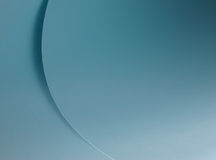Blue curves. Shades and cirves created by a blue paper sheet Royalty Free Stock Photography