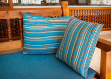 Blue cushions on the wooden sofa in the park Royalty Free Stock Photo