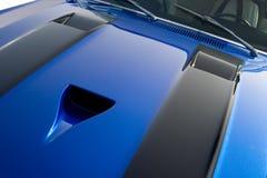 Blue custom American muscle car. Engine hood on a blue custom American muscle car with black stripes Stock Photo