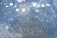 Blue cute shiny glitter lights defocused bokeh abstract background with falling snow flakes fly, festival mockup texture with blan. Blue beautiful shiny abstract vector illustration