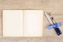Blue cutlery and bow with book and text space Stock Image