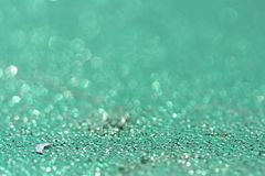 Blue or cyan background with glitter. Christmas, New Year, Holiday and wedding abstract texture. Blue or cyan background stock photo