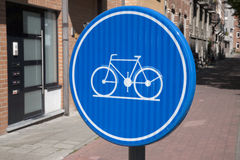 Blue Cycle Lane Sign, Leuven, Belgium Stock Images
