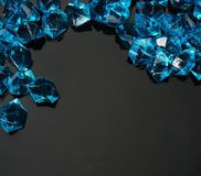 Blue cystals. Many blue gems on black Stock Image