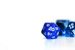 Blue d20 gamer dice. A blue twenty sided die Royalty Free Stock Images
