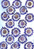 Blue daisies. Daisies in blue and gold on a light blue background Stock Photography