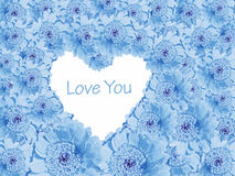 Blue daisy background with love heart. Light blue background of cutout gerbera daisy with heart shaped copy space and message Love You Stock Photography