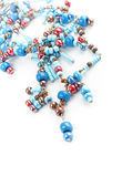 Blue and dark red glass beads Royalty Free Stock Photography