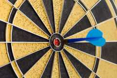 Blue Dart in bull's eye Royalty Free Stock Images
