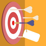 Blue dart on the middle of the target with empty tag. Royalty Free Stock Image
