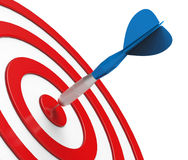 Blue Dart on Red Target Close-up Royalty Free Stock Image