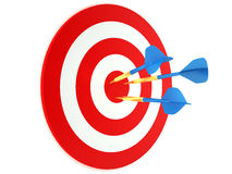 Blue darts in red and white target. High quality render of blue darts stuck in red and white target Stock Images