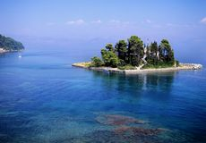 Blue day. A small island off the coast of Corfu town, greece royalty free stock photo