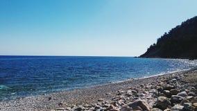 Beach of Kargicak Kemer Turkiye. Blue day daylight Royalty Free Stock Photo