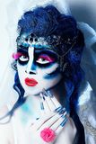 Blue dead bride. Beautiful woman dead bride. Jewelry white long veil, red lips. Creative dark makeup, conceptual idea for Halloween. Eerie nightmare darkness royalty free stock photos