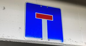 Blue german dead end road sign hanging. Blue dead end road sign hanging on a concrete wall in germany Royalty Free Stock Photography