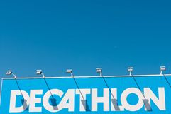 Blue Decathlon store entrance. With night lightnings on perfect blue sky stock images