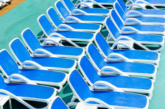 Blue deck chairs Royalty Free Stock Image