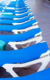 Blue deck chairs arranged around the pool before or after the en Royalty Free Stock Photo
