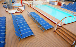 Blue Deck Chairs neatly placed on a Ship Deck Royalty Free Stock Photography