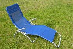Blue deckchair Stock Images