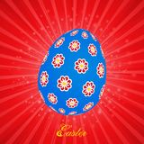 Blue decorated Easter egg on Red Star burst Stock Photo