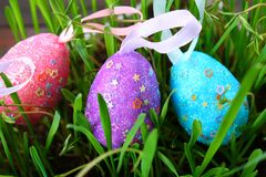 Blue decorative eggs on a background of green grass. Easter. stock photography
