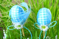 Blue decorative eggs on a background of green grass. Easter. stock image