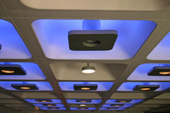 Blue decorative funky coloured indoor lights. Blue decorative funky coloured indoor ceiling lights stock photography