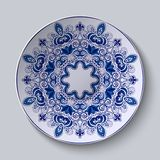 Blue decorative ornament. Pattern is applied on a ceramic plate. Vector illustration Stock Photography