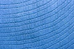 Blue decorative relief plaster on wall closeup. For background stock photography