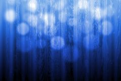 Blue defoced light over a wood texture Royalty Free Stock Images