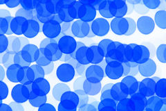 Blue defocused lights useful as a background. Good for website designs or texture Royalty Free Stock Photos