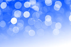 Blue defocused lights useful as a background. Good for website designs or texture. Royalty Free Stock Photography