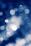 Blue defocused lights water drops blurred background Stock Images
