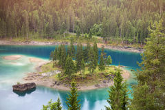 Blue degrade Caumasee lake, Grisons, Switzerland. Caumasee is a lake near Flims, in the Grisons, Switzerland- it is one of the lakes on the Flims Rockslide Royalty Free Stock Photos