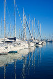 Blue Denia marina port in Alicante Spain. With boats in a row Stock Photos